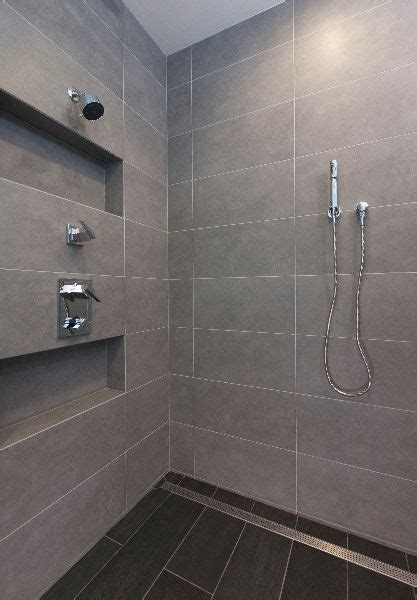 Large format tile shower and linear shower drain