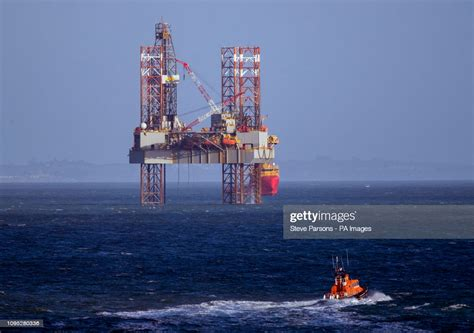 A lifeboat passes the ENSCO-72 drilling rig in Poole Bay