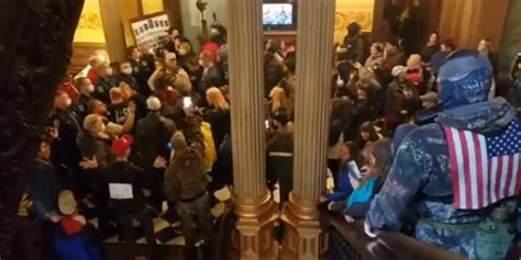 Protesters storm Michigan state Capitol demanding end to
